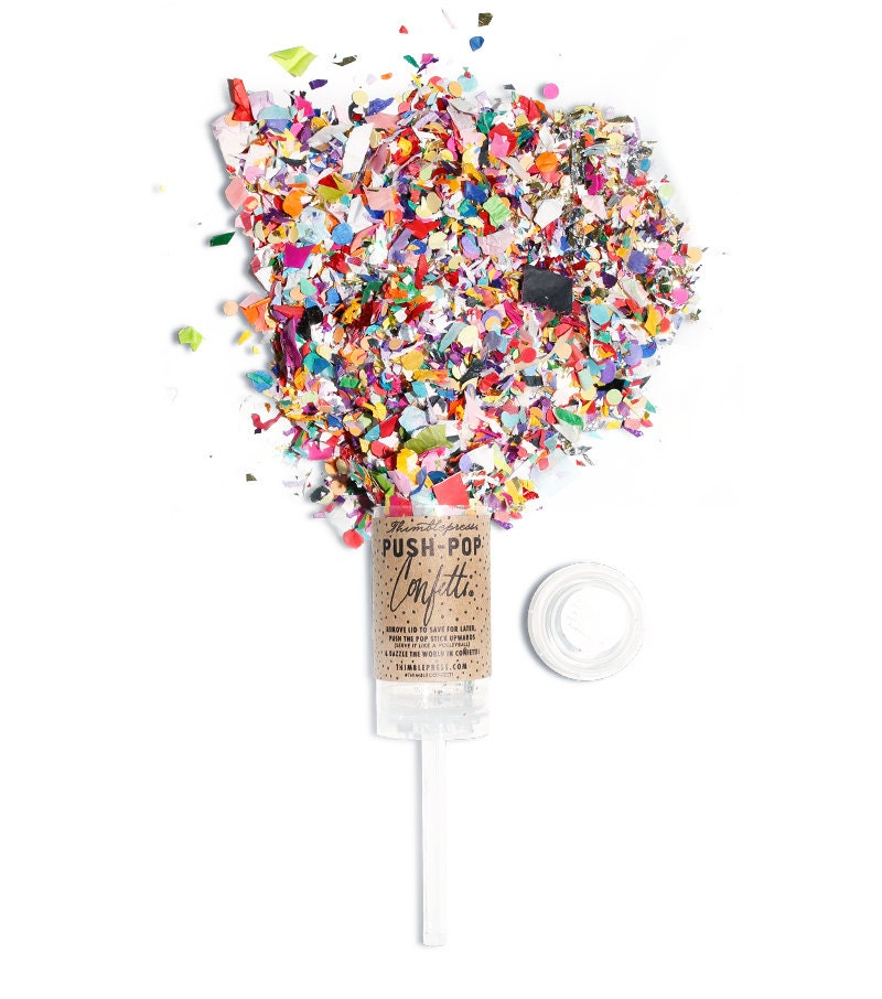 You better start punching because once the kids have made these confetti poppers, they won't want to stop popping. Even if they need a little help, you can have the older kids punch their own red, white and blue confetti while the younger ones put these poppers together.