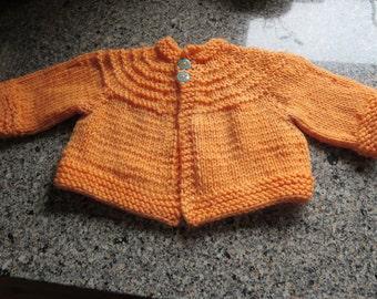 Hand knit orange baby boy or girl cardigan
