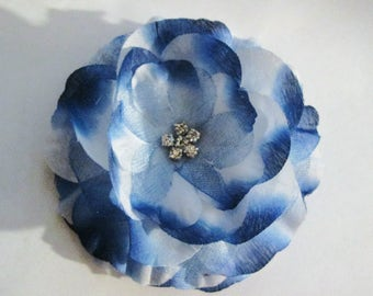Artificial blue flower on alligator clip with teeth