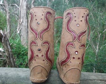 rust and red leather moccasins boots