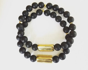 Handmade bracelet. Gold bar and black beaded stretch bracelet. Black Matte Bracelet. Double stack bracelets. Stretch bracelets. Chic.
