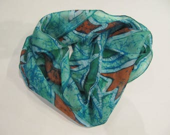 Hand-painted natural silk scarf with flowers in cool green end orange 150 x40 cm.