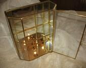 Window glass and brass, a glass jewellery Cabinet
