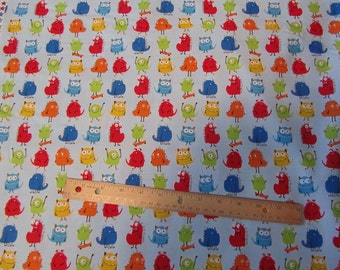 Blue with Primary Colored Mini Monsters Cotton Fabric by the Yard