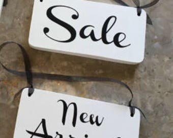 4 signs - size 8x4 each with whole and ribbon and rounds edges. Painted white with black vinyl - 2 sale 2 new arrivals