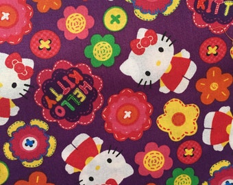 Groovy Hello Kitty with Flowers Cotton Fabric Bt The Yard