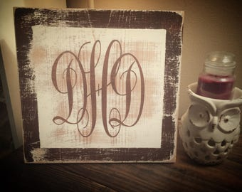 Distressed monogram sign