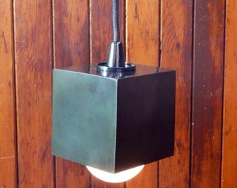 Modern lighting, minimal lighting, black cube pendant light, hanging light, bar lighting.