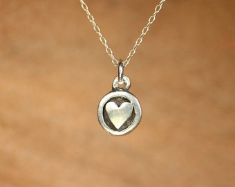 Tiny silver heart necklace - heart stamp necklace - disc necklace - a sterling silver heart charm on a sterling silver chain