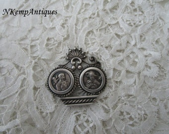 Antique silver component