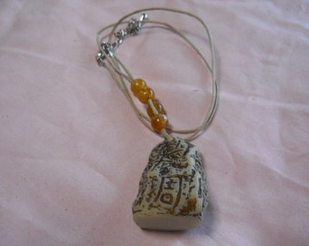 Carved Rock Necklace with  Beads on Cord