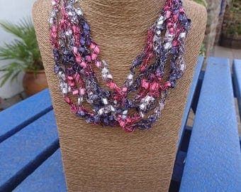Crochet multistrand necklace with tassle. Can be worn 2ways.