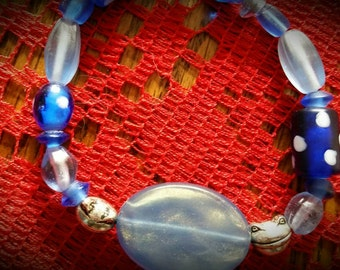 Blue Glass Bead Bracelet  (with smiling frogs)