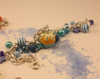 multicharm bracelet with handmade polymer clay cupcake