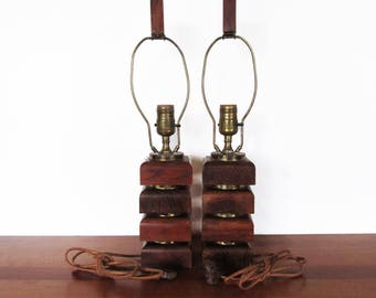 Mid Century Stacked Wood Block and Brass Ring Lamp Pair