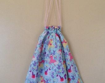 Drawstring/library/ daycare bag, pretty unicorns on an Aqua background