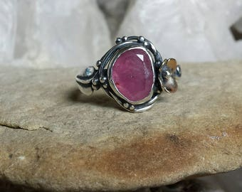 This one of a kind organic ring inspired by nature and set with a rose cut sapphire.