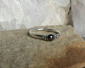 Medieval influenced hand forged Sterling Silver ring set with a natural rose cut Black Diamond