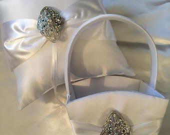 White Satin Bling flower-girl basket and matching satin bling ring pillow.