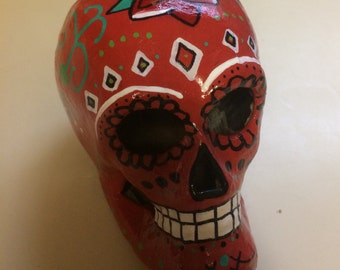 Hand-painted papier-mâché sugar skull in red