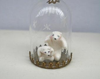 tiny glass globe and polarbears