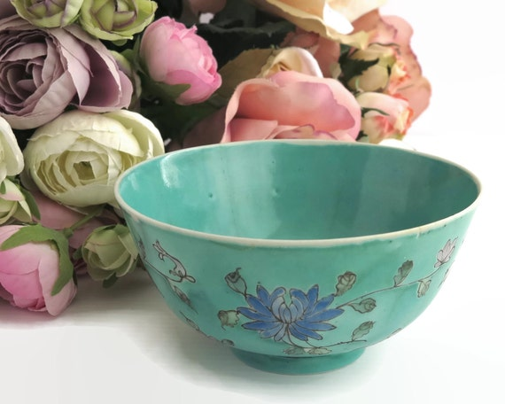 Small antique Chinese porcelain bowl, turquoise color with hand painted waterlilies and other flowers in lilac and blue, circa 1920s