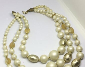 Vintage multistrand white beige and gold necklace