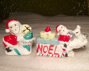 Vintage Old Christmas Santa on a Sleigh with Gifts and a Reindeer and Santa with Gifts going down the Chimney Figurines