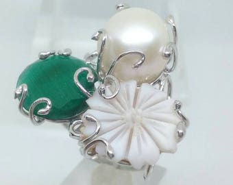 Silver ring with cameo and bead.