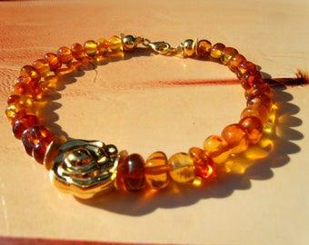 Baltic amber bracelet pink gold