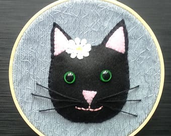 Smiley padded black cat ,fabric collage and embroidery in a hoop