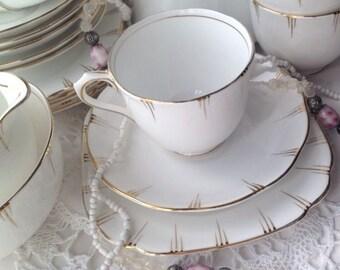Royal Albert Tea Cup Trio. White & Gold Art Deco Style English tea set