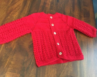Hand knit red baby sweater/cardigan with flower buttons