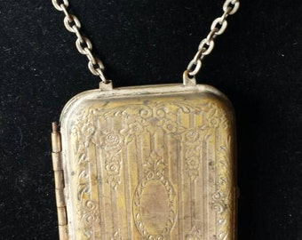 Antique Victorian Metal Coin Purse, brass worn Silvertone finish. Spring Latch works well. Coin slots are spring loaded. Tempt Team.