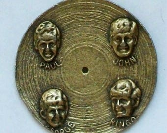 BRASS Beatles Charm that Looks Like Old Fashioned Record! Each Beatle on the Other Side! Retired! Out of Production and Hard To Find!
