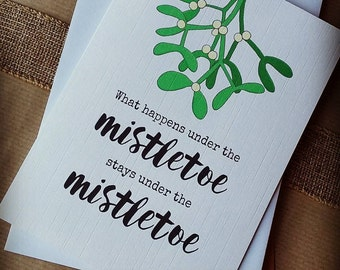 Christmas Card - What happens under the mistletoe, stays under the mistletoe