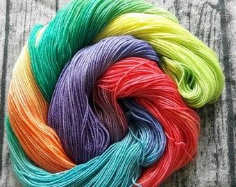 Rainbowed. Rainbow coloured superwash merino and nylon sock yarn. 4 ply. Hand dyed yarn.