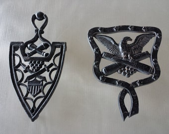 Mid Century Colonial Early American Cast Iron Trivet Set of 2 wall art Eagle Cannon Swords