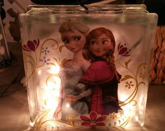 Glass block night luck for that special daughter. Elsa and Anna