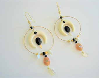 """Golden hoops, Horn, mother-of-Pearl, real stones and Swarvoski crystals. Earrings """"BOHEMIAN-CHIC"""", tribal horns."""