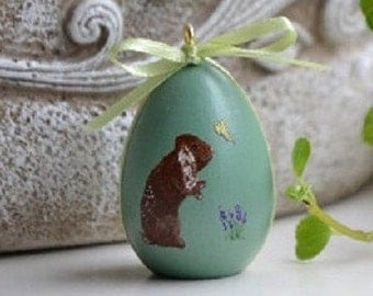Bunny and Butterfly painted on birch wood egg.