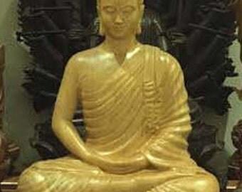 Gautama Buddha statue made from  fokienia wood