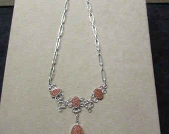 Elegant Goldstone STERLING silver necklace with a lacey look.