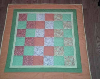 Quilted baby blanket, it would make a great baby shower gift,or for your little one.