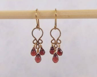 Gold Chandalier earrings with granats