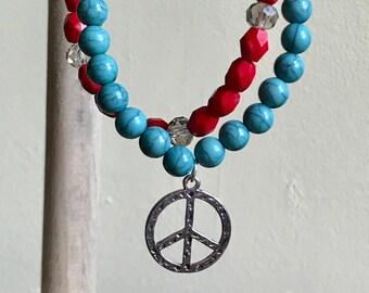 Peace charm beaded bracelets, set of 2 red and blue beaded stretch bracelets