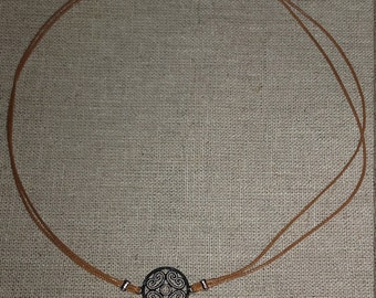 Ras neck cord necklace