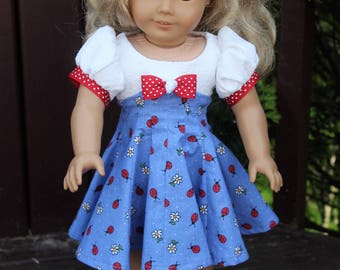 Vintage 50's dress only. Dress has a whimsical flair of lady bugs and daisies. Fits American Girl doll and other 18 inch dolls
