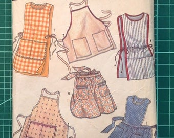 Vintage Uncut Sewing Pattern - Simplicity 7052 One Size Aprons
