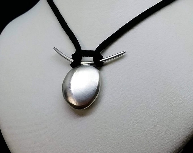 Sterling silver pendant with a matte finish